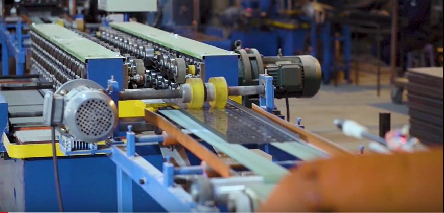 dây chuyền sản xuất kệ công nghiệp VNT